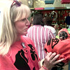 10-23-99---Darlene Wright, of Longview, holds Eva, her minature Chihuahua dressed as pumpkin during the Halloween Costume Contest Saturday afternoon at Wet Pets and Critters in Longview. Darlene won first in the funniest division. Kevin Green