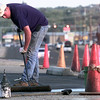10-25-99---Leland Smith, with Leland Enterprises, of Longview,  brushes on a coating on the parking lot at Alcatel  Monday afternoon on HWY 80 in Longview. Kevin GReen