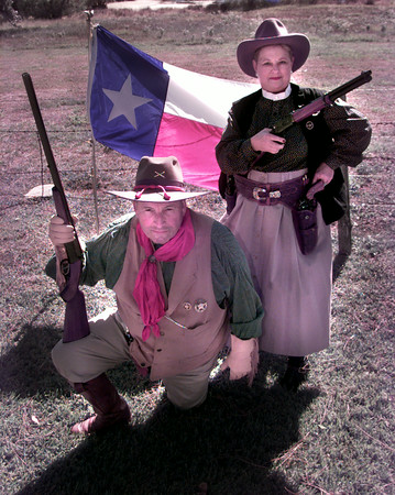 10-25-99---Jim and Linda Stroud in their Cowboy Action Shooting outfits at their home in Joinersville. Keivn GReen