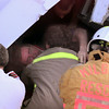 10/11/99---Truck driver David Coverdale of Fort Worth reaches out for a rescue worker as they try to free Coverdale from his cab after he overturned Monday off I-20 and into Harris Creek. Coverdale was pinned inside his rig for nearly two hours before he was freed and airlifted to East Texas Medical Center in Tyler.