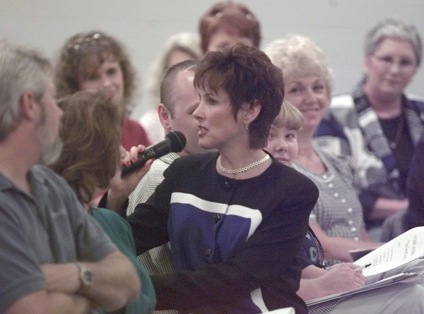 10/12/99---Eileen Shenker sits in the audience to make a point Tuesday while conducting a telephone skills seminar at the Exhibition Center in Longview. The workshop was sponsored by the Longview News-Journal. bahram mark sobhani
