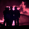 10-4-99---Firefighters from the Northeast Texas Fire School train Monday night at the Eastman training field in Longview. Kevin Green