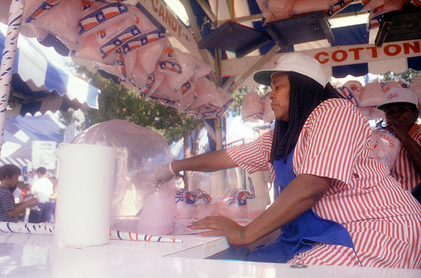 10-6-99---Tina Stone makes cotton candy in her booth at the State Fair of Texas as she has the past 39 years under the Texas Star. Kevin Green