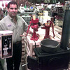 10-5-99--Al Horaney, with Horraney's Inc., holds a lamp, left, and stands beside a grist mill, a picture pump, and a casat iron dutch oven, which people might purchase of they are afraid of YYYY22222KKKKK bug. Kevin Green