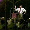 10/6/99---With a bible tucked under his left arm, the Rev. Charles Costello delivers a message to the crowd gathered Wednesday at the Ore City Area Wide Revival. bahram mark sobhani