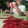 10/13/99---Kelli Shipley and Chad Cates, freshmen at Pine Tree, work on pinning ribbons Wednesday at Longview High School, to be used for Red Ribbon Week. bahram mark sobhani
