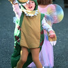 10-27-99---Grant Lehenbaur, 3, spins around in his T-Rex costume during the First Christian Prep School halloween parade Wednesday morning at  the church in Longview. Keivn GReen
