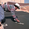 10-12-99---Bulmaro Mederos, with Alpha Concrete, smooths concrete Tuesday afternoon at the Heritage Plaza in Longview. Kevin Green