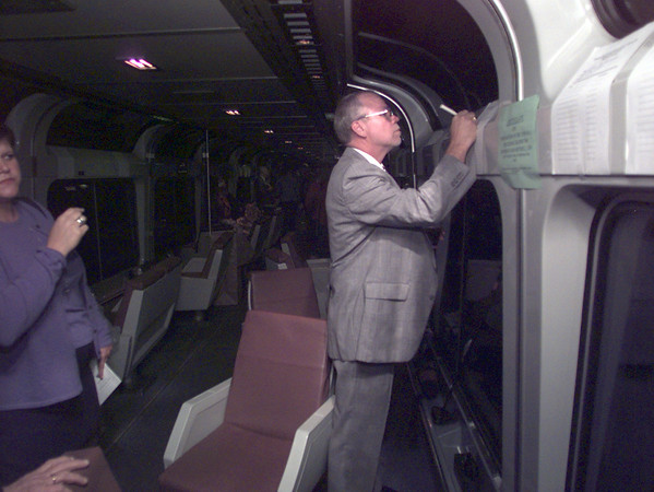 "10/8/99---Bob Tippit of Longview makes a bid on a pair of sunglasses at the silent auction on board an Amtrak train at the station in Longview during the Special Health Resources of East Texas fundraiser, ""Midnight Train to Nowhere"" Friday night."