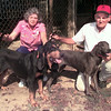 10-14-99---Martha, left, holding Maggie, an old time American Black & Tan hound, and husband Gene Sowell, holding Blue Bonnie Faye, a Plott Hound, at their home in Center. Kevin Green