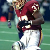 10-24-99---Washington Redskins #37 Larry Centersis tackled after cathing a pass in the fourth quarter of play Sunday afternoon against the Dallas Cowboys in Irving. Kevin GReen