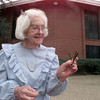 10/7/99---Grace Phillips, 87, holds nails used in the construction of the original Macedonia Baptist Church building outside the current church. Phillips' family were charter members of the church when it opened 100 years ago. bahram mark sobhani