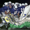 10/15/99---The New Diana Eagles football team rips through a banner as they take the field against the West Rusk Raiders at Eagle Stadium Friday night. bahram mark sobhani