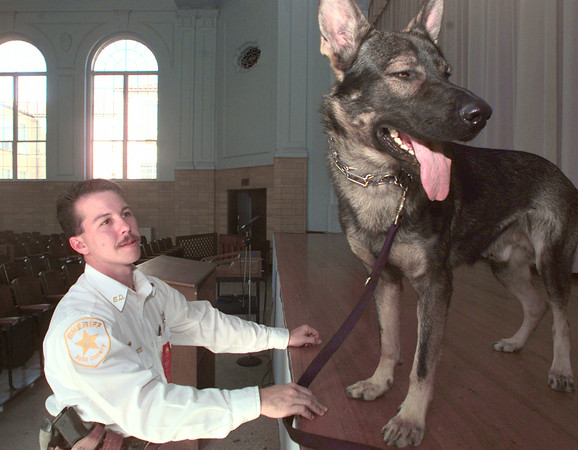 10/27/99---Rusk County Sheriff's officer Stephen Strong and his K9 unit Lars wait in the West Rusk High School auditorium Wednesday prior to a Red Ribbon Week program. Lars, a new addition to the Sheriff's department, has been used heavily in schools with educational programs as well as drug searches. bahram mark sobhani