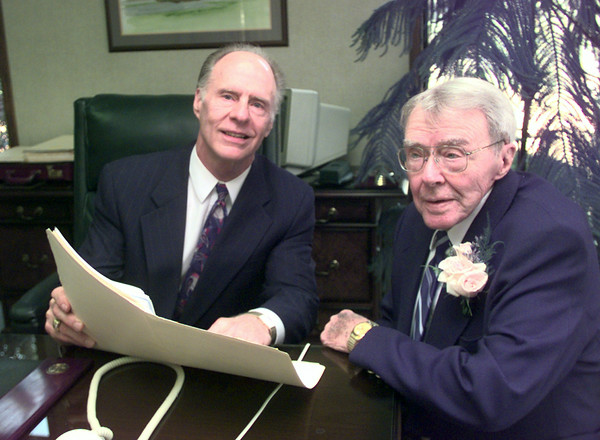 10-14-99---Allstate insurance agent Jerry Hawley, left, with customer of 65 yrs. John Friton, right, in Jerry's office Thursday in Longview. Kevin Green