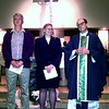 First Lutheran representatives,Vernon Amundson left and Education and Youth Minister Barbra Morgan in a joint prayer service with Father Gaven Vivaerek at St. Mary's Catholic Church. Obie LeBlanc.
