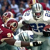 10-24-99---Dallas Cowboys Emmitt Smith, right, runs the ball as the redskins #94 Dana Stubblefield, left, attempts to make a tackle during Sunday afternoon's game in Irving. Kevin Green