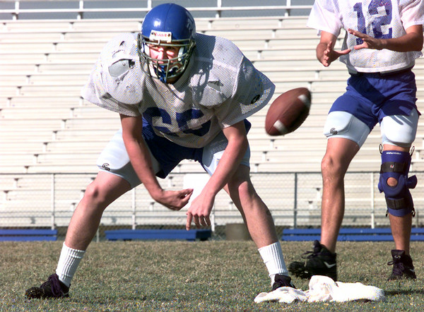 10-13-99--Spring Hill player ????? hikes the ball to Qb during practice. Kevin Green