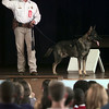 10/27/99---Rusk County Sheriff's officer Stephen Strong speaks to West Rusk students Wednesday during a Red Ribbon Week program. With Strong on stage is his K9 unit Lars. bahram mark sobhani