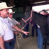 10-4-99---Houston SPCA director Dave Garcia, left, speaks to a group during a class on animal cruelty with emphasis on horses Monday afternoon at the Longview Fairgrounds in Longview. Kevin Green