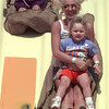 9/18/99---Christie Goss of Overton rides the Super Slide with her children Meghan, 3, and Paul, 6, Saturday at the Gregg County Fair. bahram mark sobhani