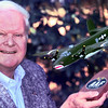 9/29/99---Peppy Blount poses for a picture with an exact replica of his plane Touch O' Texas. Friends Robbie Robinson, and Howard Selph, both of Longview, had the plane special made then they presented the plane to him. Kevin Green