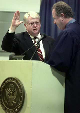9/24/99---T. John Ward takes the Oath of Office, administered by longtime friend and U.S. District Judge W. Royal Furgeson, Jr. at Ward's swearing in ceremony as U.S. District Judge of Eastern District of Texas. Ward was sworn in during a special session meeting of the court Friday at the Maude Cobb Convention Center. bahram mark sobhani