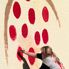 9/23/99---Angelia Ewing, of Longview, paints a pepperoni on a pizza on the side of Pizza Inn on East Marshall Ave. Thursday morning in Longview. Kevin Green