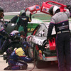 Pit crew members for Dale Earnhardt complete a pit stop during the Primestar 500 at TMS in Ft. Worth, Texas. Kevin Green