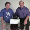 9/16/99---Bonnie Sistrunk, left, with her dog Seffery, center a nine year old black lab that is an aminal assisted therapy dog, presents a $2,500.00  check to Fred Killingsworth, right, the director of the Humane Society, from the Longview Kennel Club from the gate and catalog fee proceeds from from a past dog show in Longview. Kevin Green
