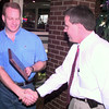 9/21/99---LPD SGt. John Allen, left, is presented with a plaque by LPD SGT. Mike Bullock, right, Tuesday afternoon at Chili's in Longview during a going away luncheon.Kevin Green