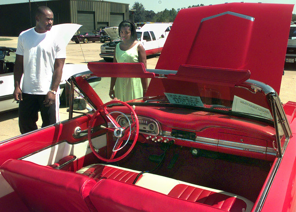 9/11/99---Luther and Monic Freeman, of Longview, take a look at Jimmie Pullins 1963 Ford Falcon Futura, during Saturday's United Truckers sixth annual truck, car, and bike show at R&K Distributors in Longview. Kevin Green