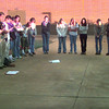 9/15/99---LHS students form a circle while praying at the flagpole at daybreak Wednesday morning at the LHS campus in Longview. Kevin green