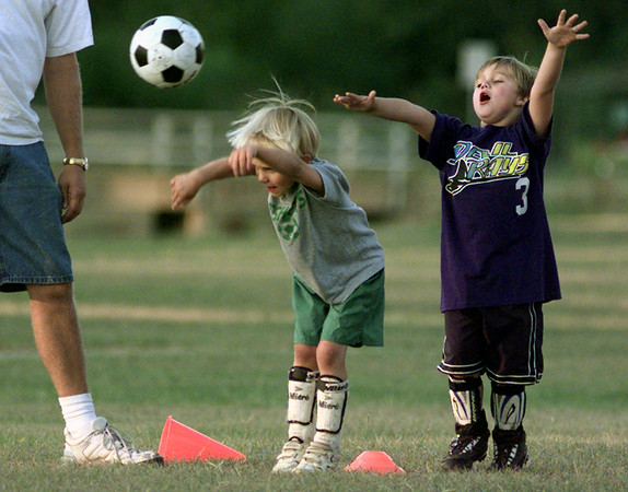 9/21/99---Bode Barber, right, does a back up imitation of Cameron Morriss as Morriss practices sideline throw-ins during practice of the Hotshots under six seniors soccer team Tuesday at Guthrie Park in Longview. bahram mark sobhani