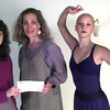 9/11/ 99---Target team relations person Cynthia Starr, left, presents a check to Pat George Mitchell, center and Bridget Rambo, right, with Longview Ballet. Kevin green