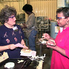 9/22/99---Chaplain Dottie Bachtell, left, visits with LeT. emp. Mary Rollins, right, in the electrical motor building Wednesday morning at LeTourneau Inc in Longview. Kevin Green