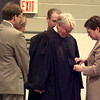 9/24/99---Elizabeth C. Ward robes her husband T. John Ward after he took an Oath of Office to the U.S. District Court at a special session meeting Friday at the Maude Cobb Convention Center. Surrounding the two are their children, Susan E. Ward, T. John Ward, Jr. and David C. Ward. bahram mark sobhani
