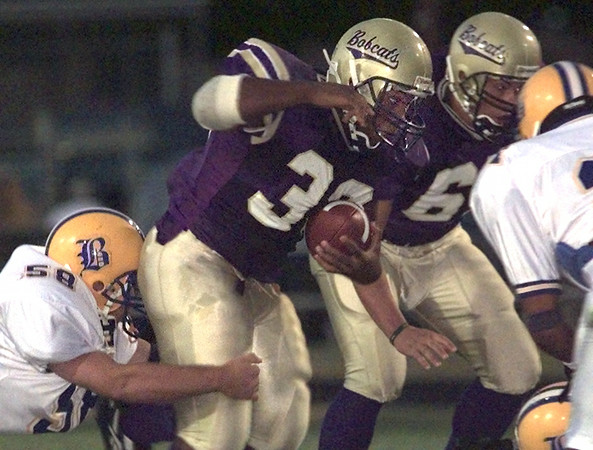 9/10/99---Hvill's #39 Sedanio Brown is brought down by Brownsboro #58 Daniel Wright during Friday night's game in Hallsville. Kevin Green