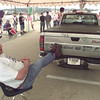 9/30/99---Jay Mallard sits with his legs propped up on the prize truck during the Hands on a Hardbody contest last week. bahram mark sobhani
