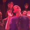 9/15/99---A student raises his hands in praise as Christian music is played at a youth rally in Lobo Coliseum Wednsday evening. bahram mark sobhani