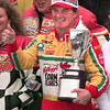 NASCAR driver Terry Labonte gives a thumbs-up while holding the Primestar 500 trophy at TMS in Ft. Worth, Texas. Kevin Green