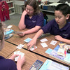 9/29/99---Left to right--Trinity fifth-graders Angie Heaberlin, Sarah Beck, and Antonio Lau, play a math card game during Donna Sharp's class Thursday morning at Trinity School of Texas. Kevin green