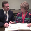 9/16/99---Brad Bunt, left, and Sandra Russell, right, talk about the up-coming seminar. Kevin green