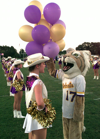 9/10/99---A Hallsville Bobcat Belle officer gets distracted before the game by Hallsville High School mascot Lydia Kosinar, right, a senior, Friday night  in Hallsville prior to the Hallsville vs Brownsboro football. Kevin Green