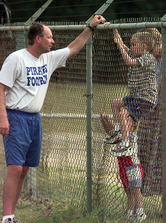 9/1/99---Pine Tree assistant football coach Mike Lee shares a few words with his sons Landry, 5, and Jantzen, 2, who came to see their dad just before the end of practice Tuesday at the Pine Tree practice field. bahram mark sobhani