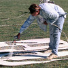 9/23/99---Spring Hill ISD maintenance employee Carla Davis, repaints the numbers on the field at Spring Hill High School in preparation of tonight's football game in Longview. Kevin Green