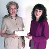 9/8/99---Bonnie Swick, left, ex dir. of the parenting resource center, is presented with a check from Target Team relations person Cynthia Starr, right, Wednesday afternoon, Kevin green