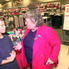 7-28-00---Trey Burda,11, of Longview, talks with Texas comptroller Carole Keeton Rylander, right, Friday afternoon at the Target store on Loop 281 in Longview. Kevin GReen