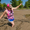 Chadron State Park Fish Move. Sarah Rodgers enters the mud of the recently drained Chadron State Park pond. Haag, Sept. 8, 2013.