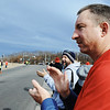 Allen Zwingle (right) of Webb City claps with the rest of the crowd as runners head for the finish of the Chilly Challenge 5K run Wednesday morning , Jan. 1, 2014, at the Joplin Family Y South.<br /> Globe   T. Rob Brown